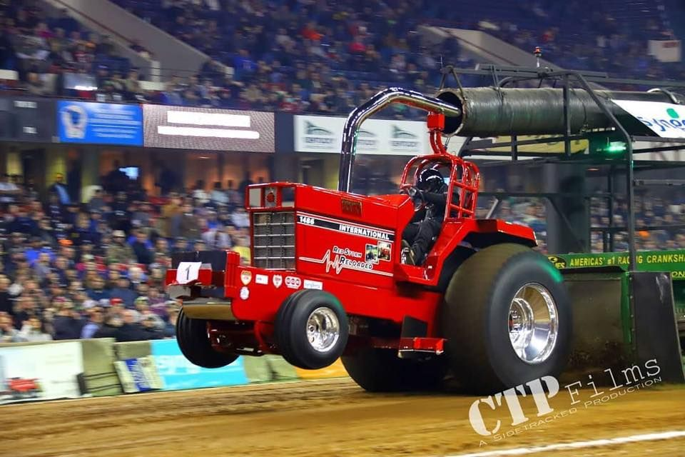 red tractor at tractor pulling event