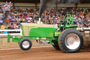 lime green tractor at tractor pulling event
