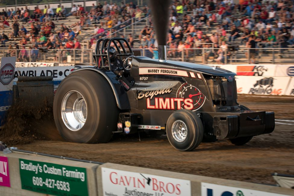 Beyond Limits tractor at a tractor pulling event outside in front of a crowd of people