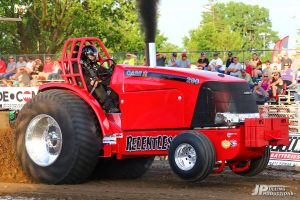 bright red tractor at tractor pulling event
