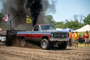 old pulling truck blowing smoke